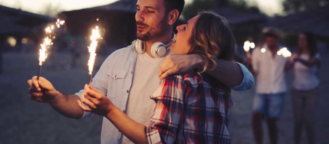 happy couple holding sparklers