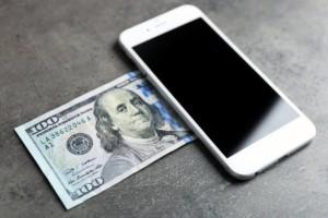 smartphone and 100 dollar bill