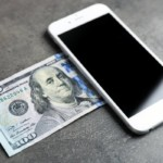 smartphone and 100 dollar bill