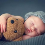 baby hugging a teddy bear