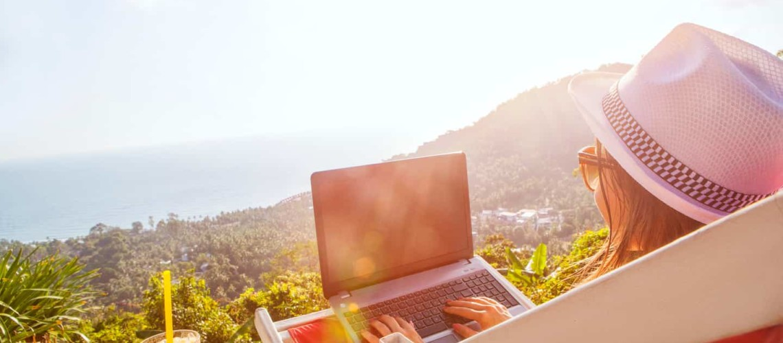 person sitting outside working on laptop