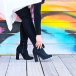 Sell Shoes Online: Girl in black shoes with colorful wall background