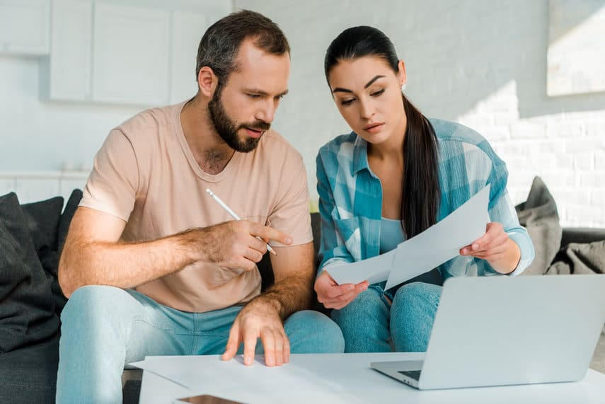 Man and Woman Discussing Saving vs. Checking Accounts