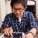 teenage boy doing work on iPad