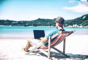 man sitting on a job working a travel job online