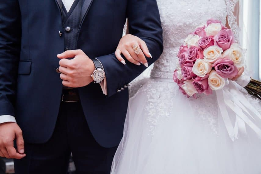 bride and groom locking arms