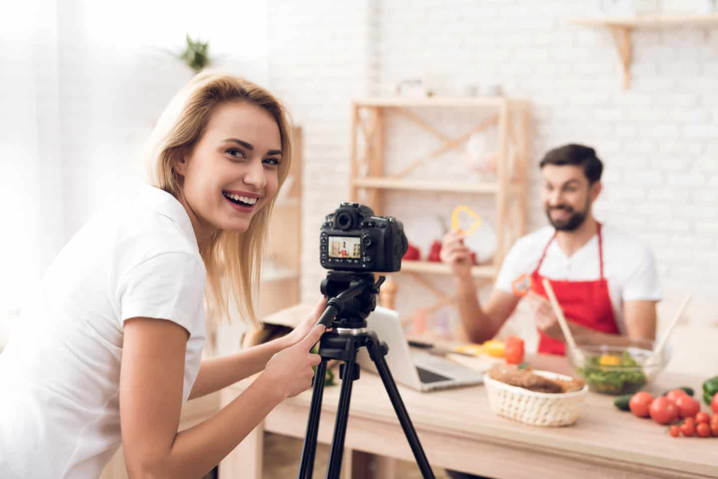 man and woman recording a cooking video