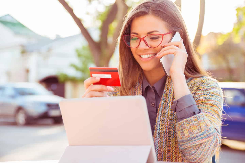Woman looking at her Visa Debit Card