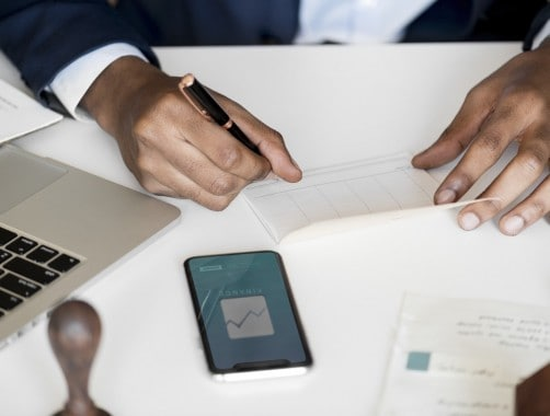 Where to Cash a Check: Man Writing a Personal Check