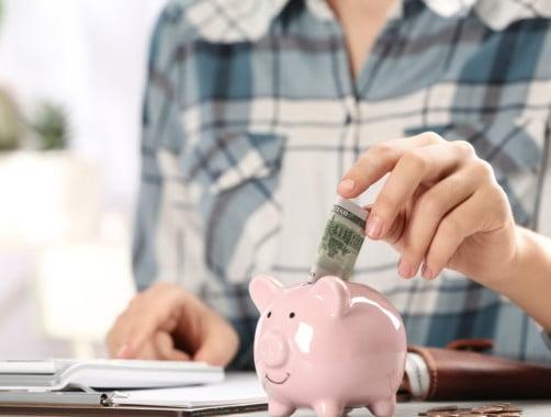 woman saving money in her piggy bank