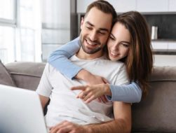 Couple searching Travel Sites online