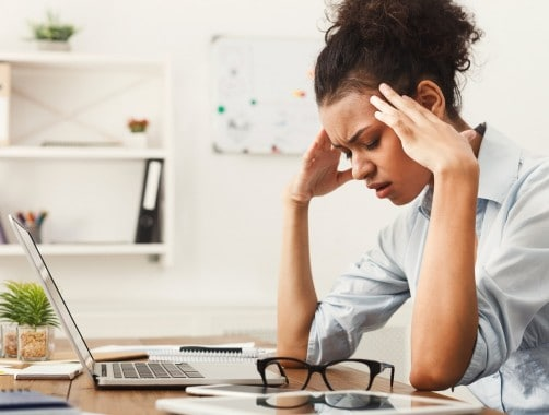 woman frustrated from living paycheck to paycheck
