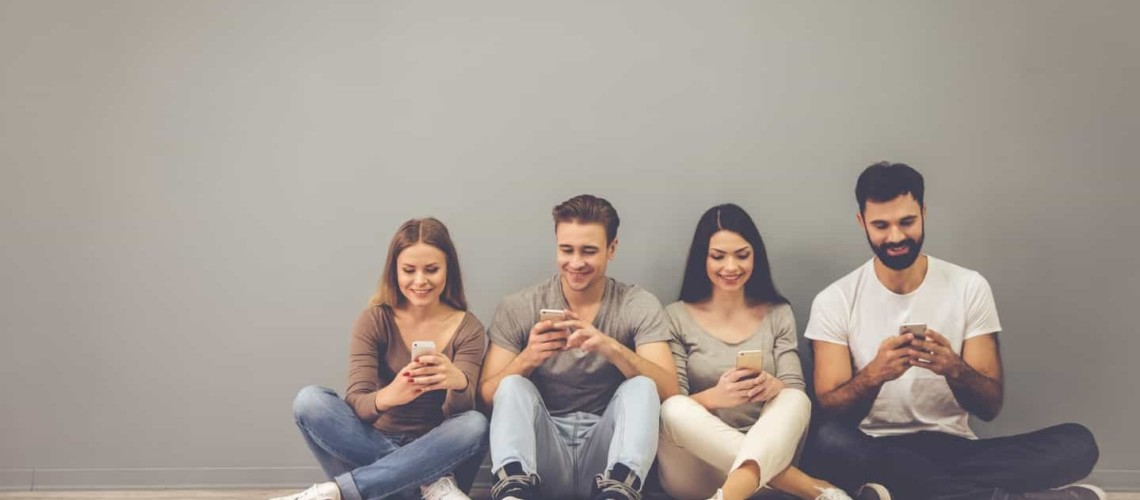 group of young micro investors using investing apps