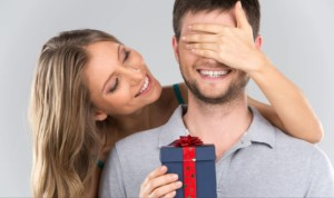 woman giving man a Valentine's Day gift