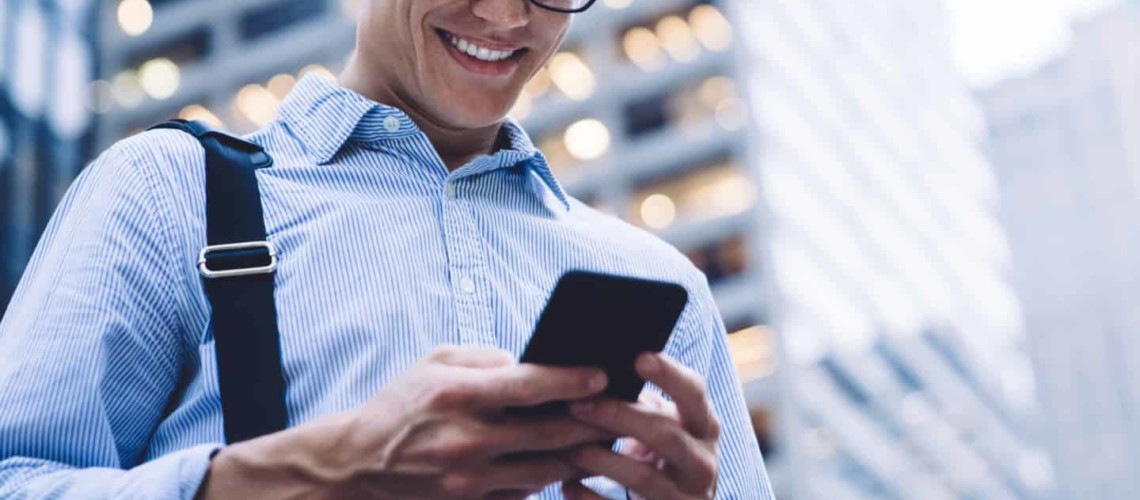 man checking banking app on his phone