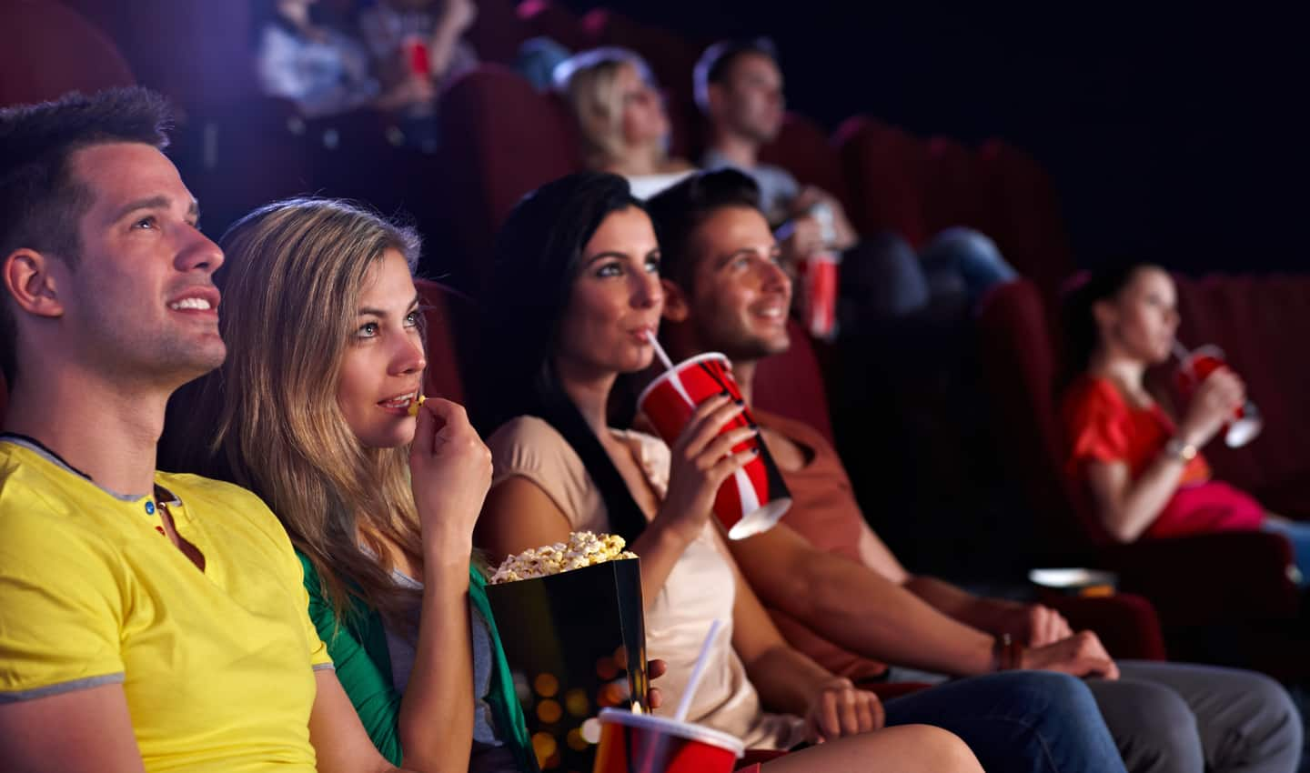 two couples watching cheap movies