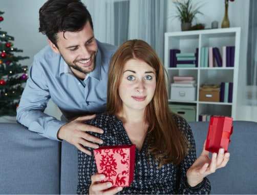 woman opening a box with a concerned face