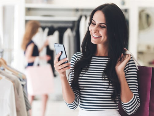 Woman Taking a Selfie While Shopping