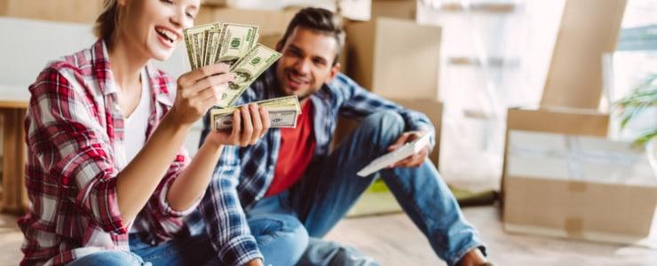 Happy couple holding money