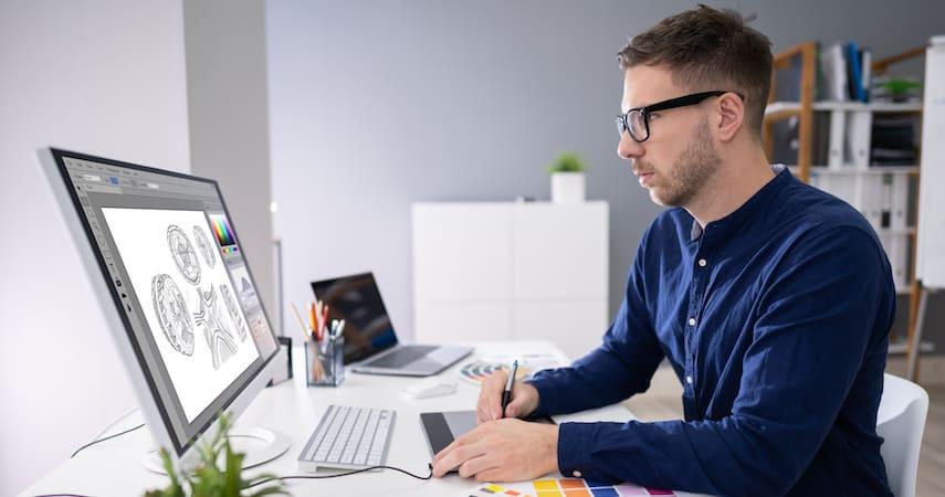man working as freelance graphic designer Andrey_Popov