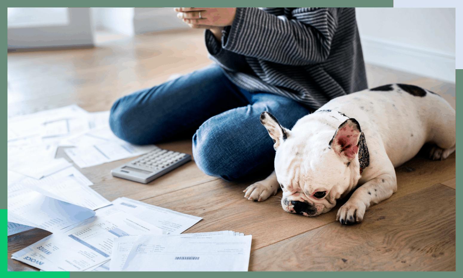 woman sitting on floor looking at bills