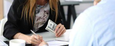 woman paying debt