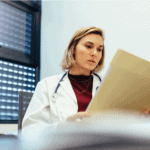 A female physician reading a chart