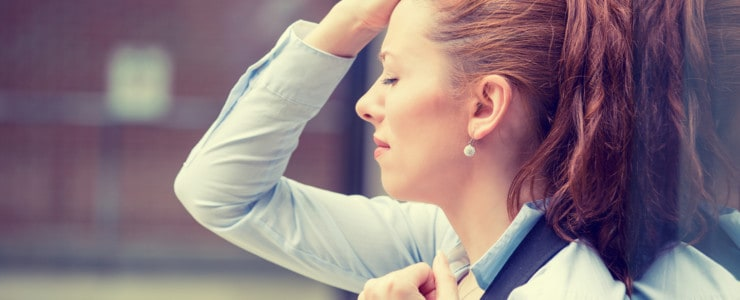 frustrated woman outside of workplace