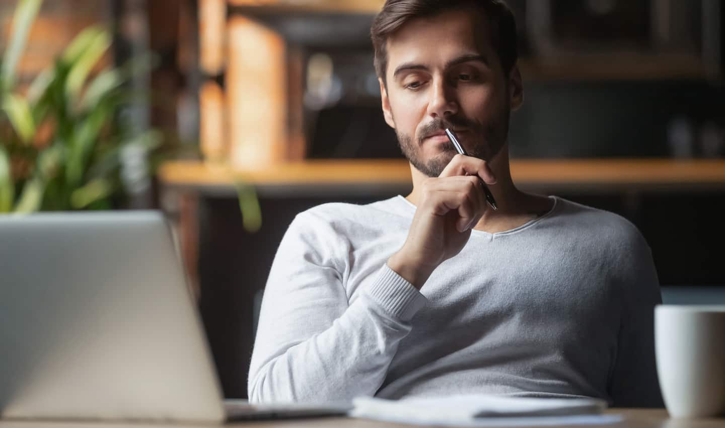man contemplating online services to offer