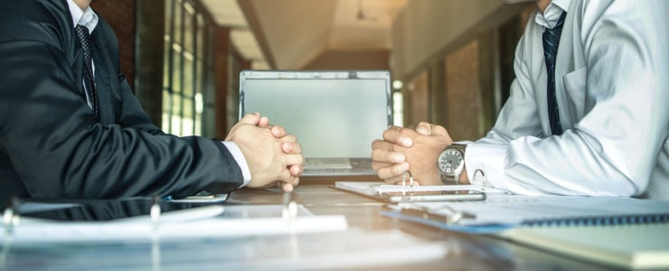 man negotiating salary with potential employer