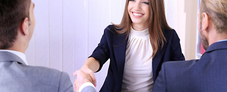 woman shaking hands at job interview