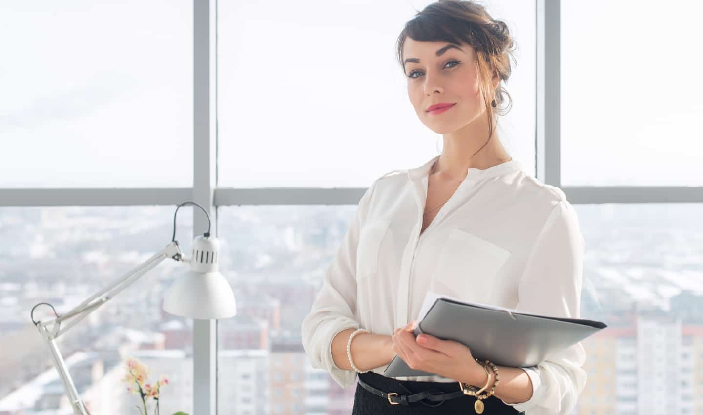 woman standing confidently at work