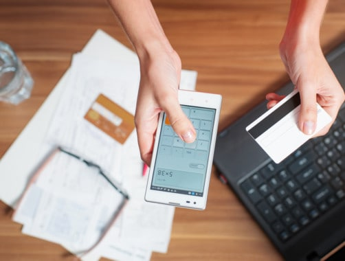 woman calculating savings on smartphone