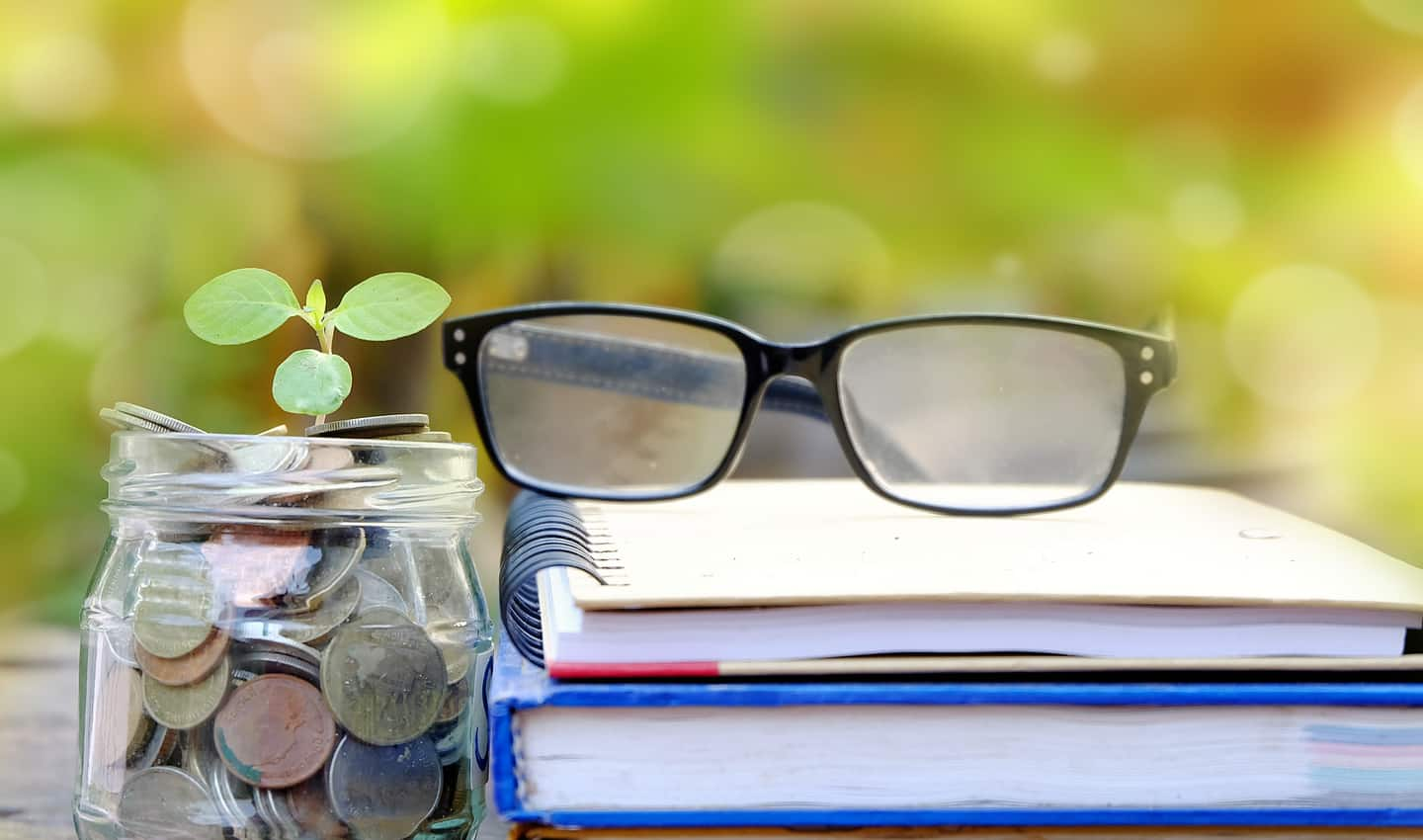 books glasses and coins