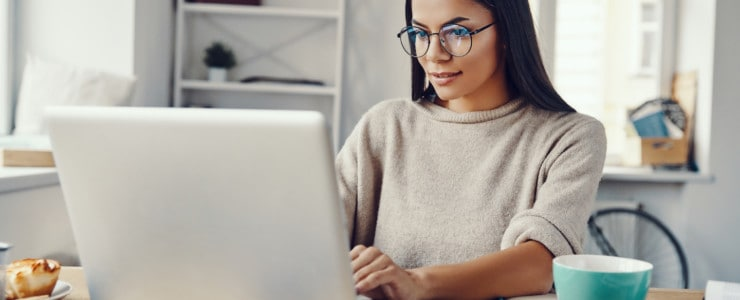 woman working from home researching blog post ideas