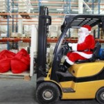 Man dressed as Santa driving a forklift