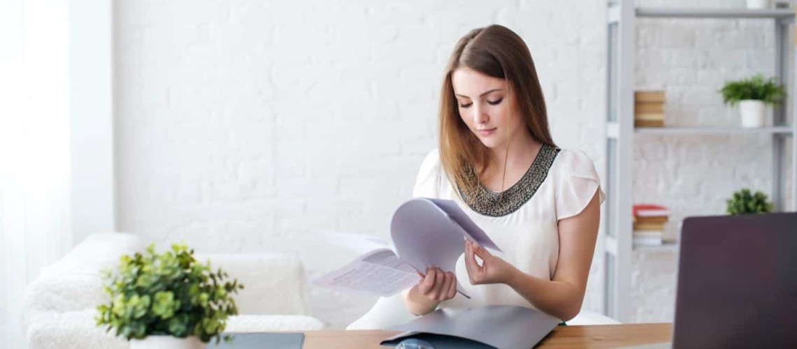 woman reading papers
